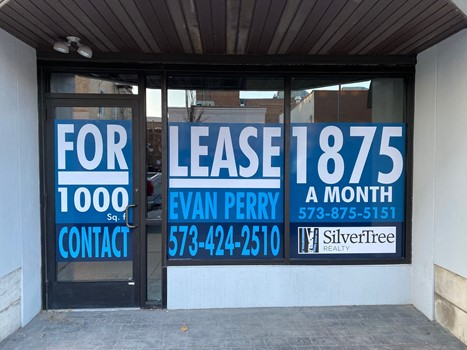 This compelling window sign was made for SilverTree Realty.