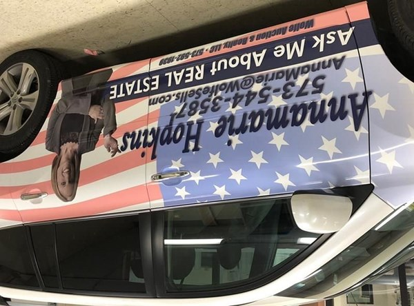 This patriotic car wrap was made for Annamarie Hopkins real estate.